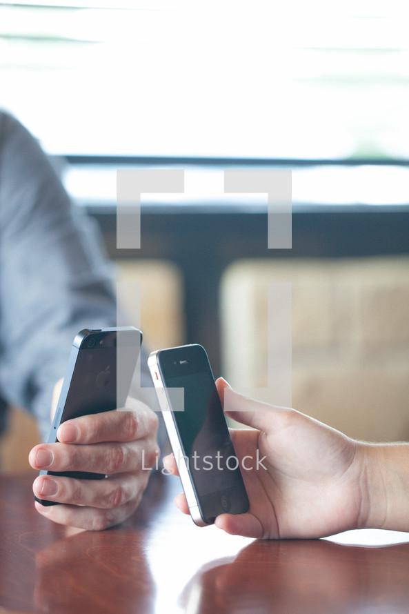 hands holding cellphones