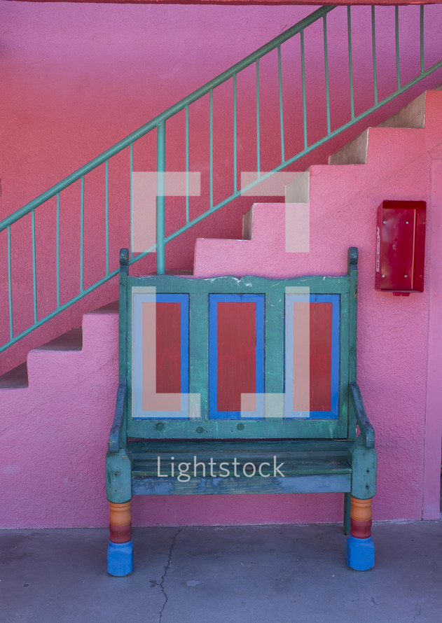 bench in a pink room