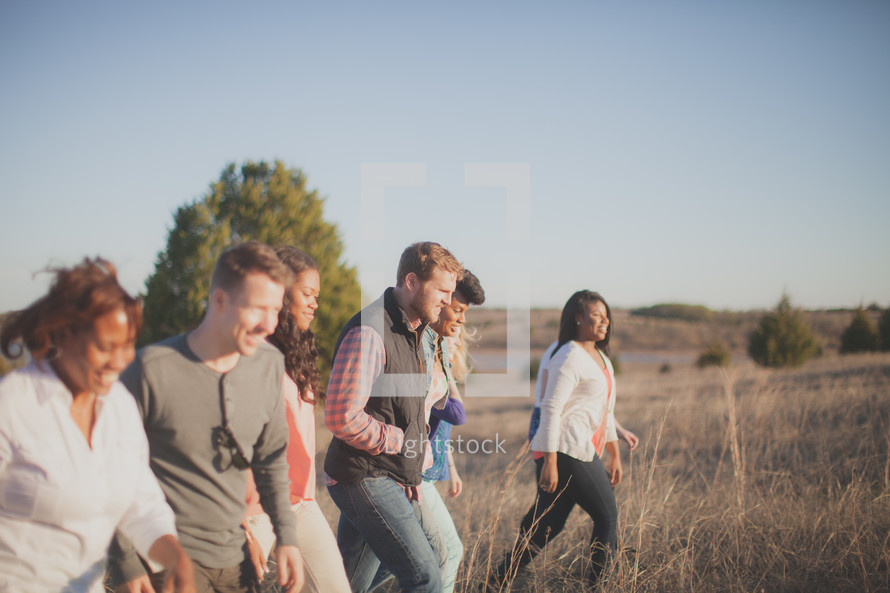 group of people walking outdoors in a field