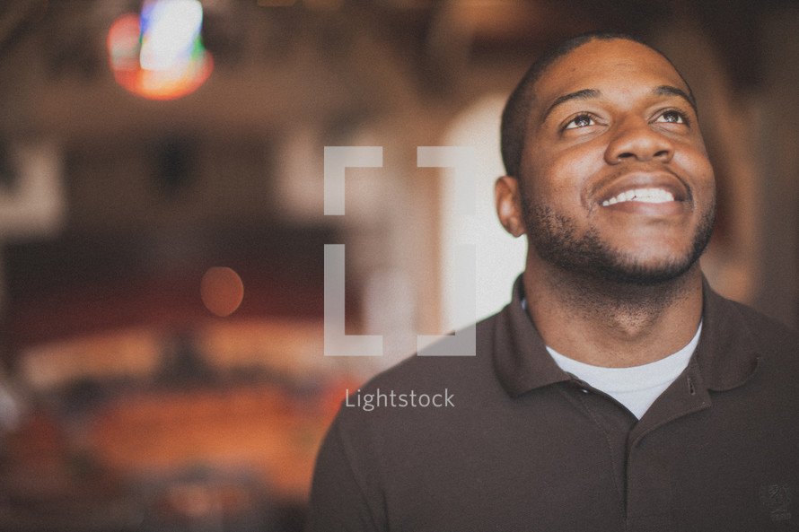 man smiling looking up to God