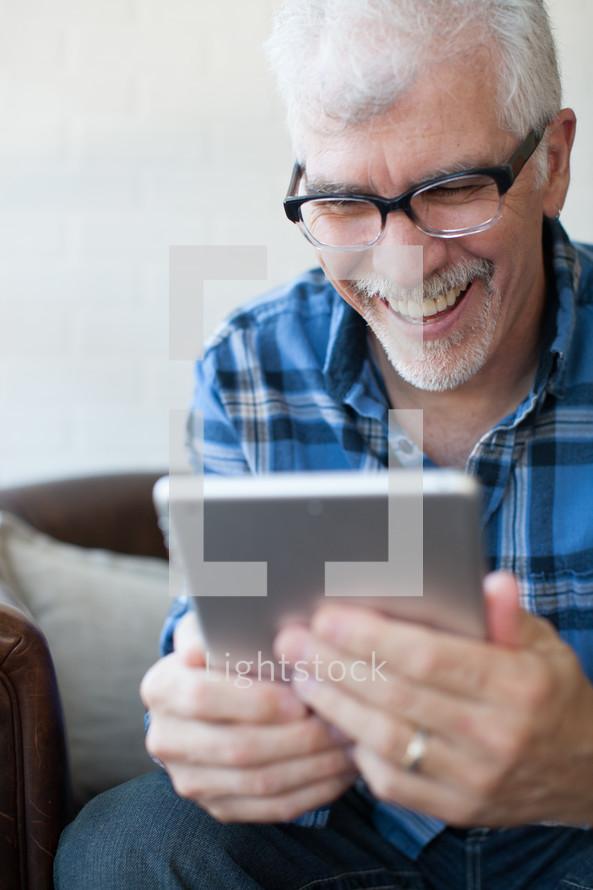 man looking at an iPad screen