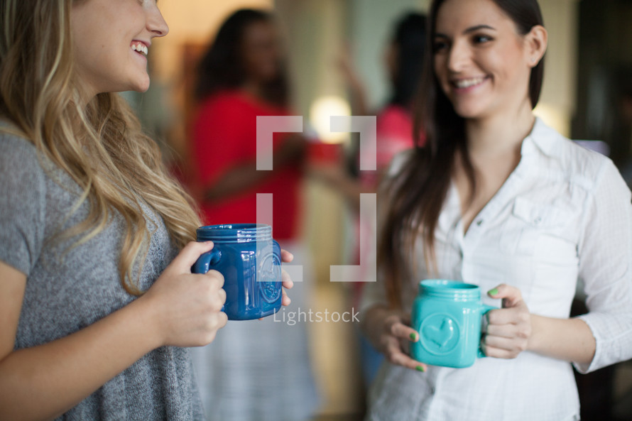 women in conversation and drinking coffee at a women's group