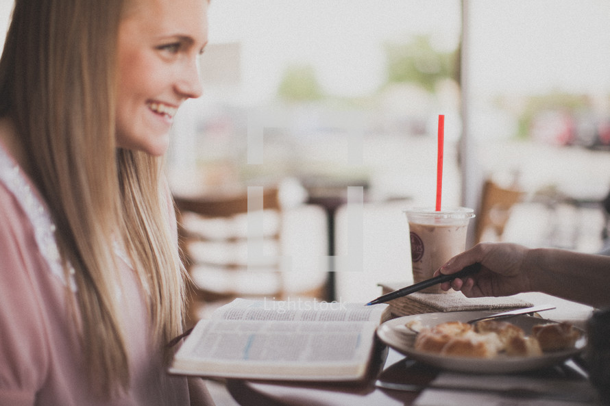 Smiling woman at a breakfast Bible study.