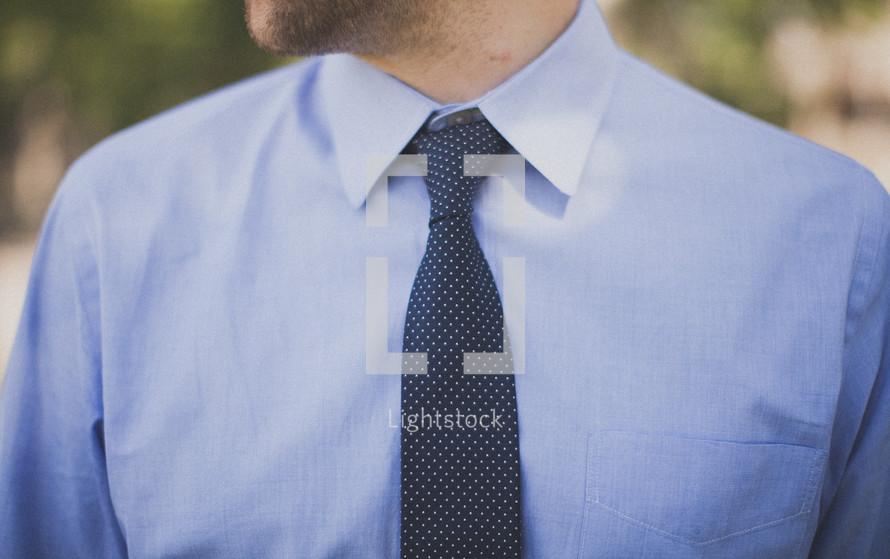 torso of a man in a tie