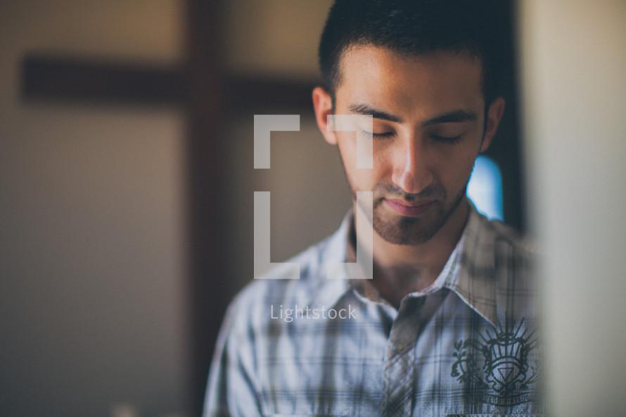 man in prayer in a church