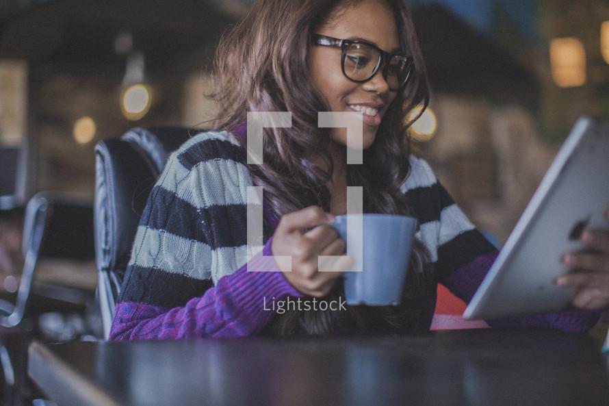 woman smiling looking at an iPad