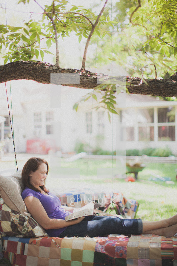 woman reading a Bible outdoors