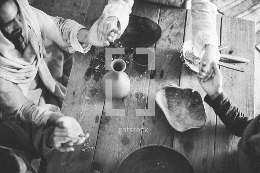 Jesus and his disciples praying before a meal