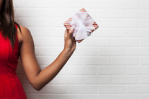 arm, African-American, holding, red dress, gift, wrapped gift, wrapped, present, Christmas