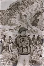 people hiking through a desert canyon