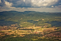 aerial view over a green mountainous landscape