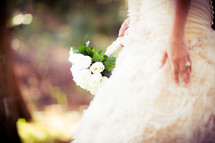 torso of a Bride holding a bouquet at her wedding