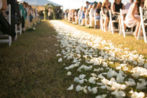 rose petals on a wedding aisle