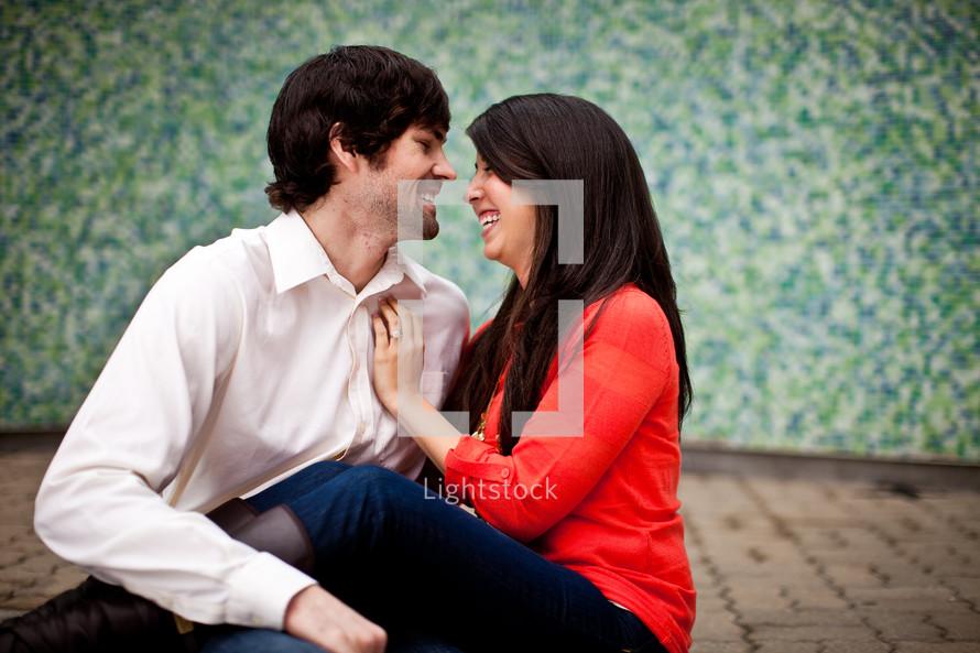 woman sitting on a man's lap