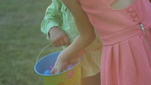 children gathering eggs at an Easter Egg Hunt