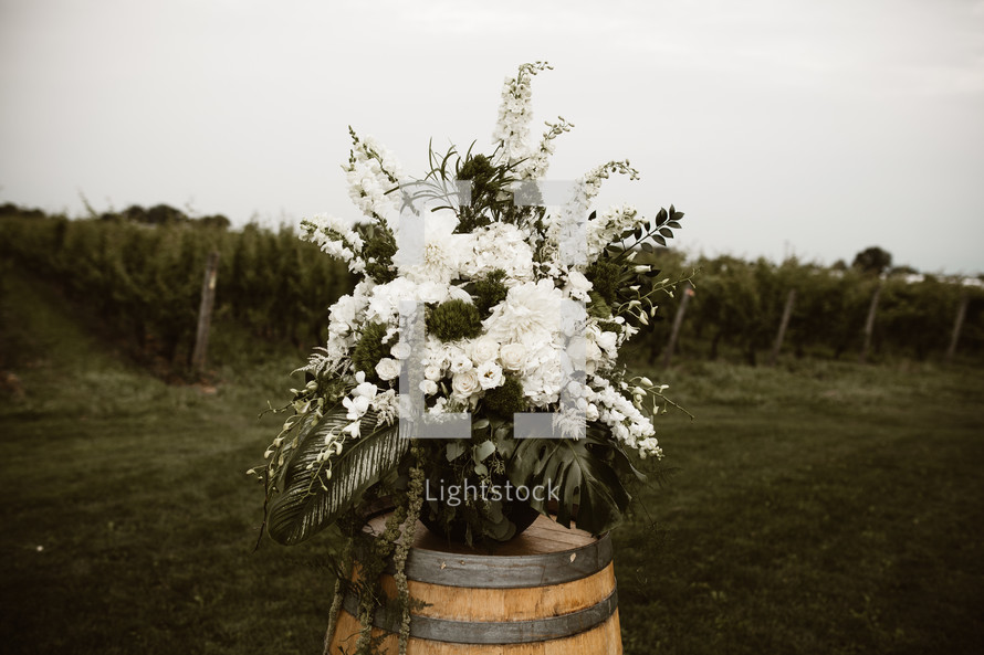 flower arrangement on a wine barrel