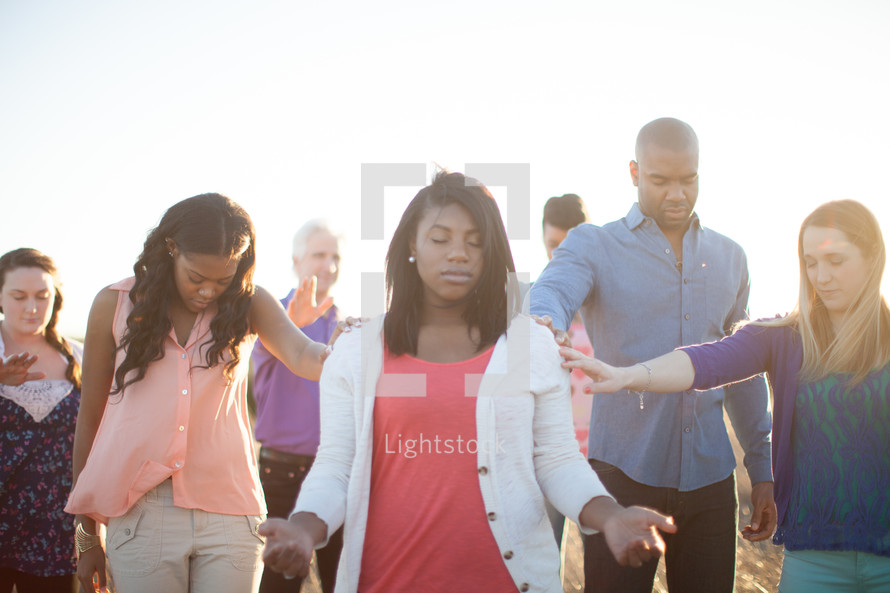 group in prayer outdoors
