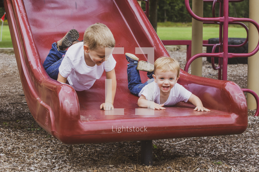 brothers on a slide
