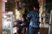 merchants in a shop in Toraja
