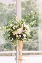 flowers in a window at a wedding