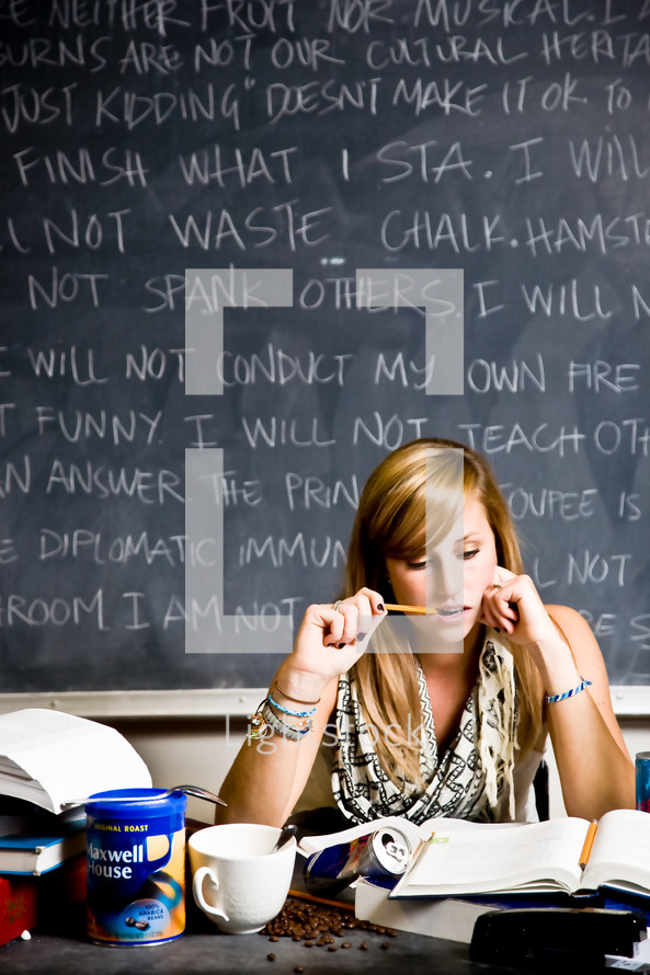student in front of a chalkboard with rules cramming for a test