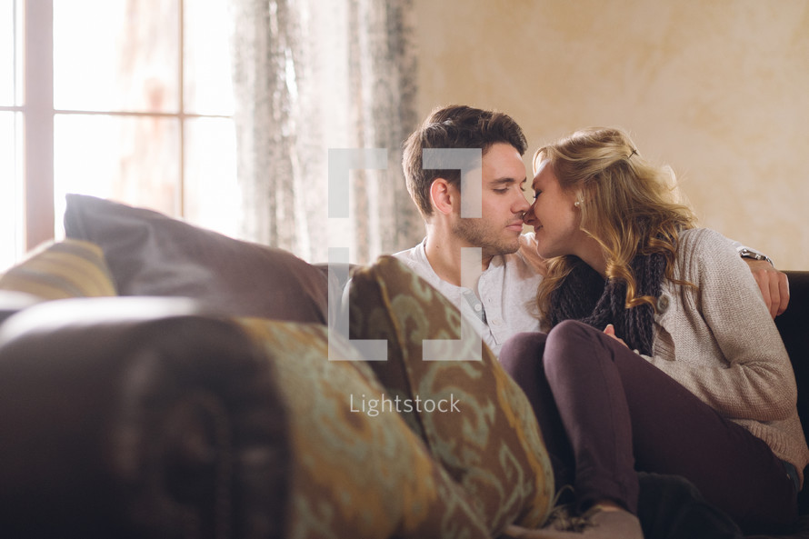 couple kissing on a couch