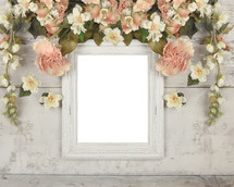 old frame surrounded by flowers