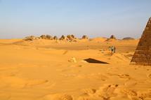 tourists visiting ancient pyramids
