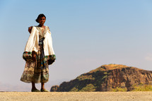 a woman standing in the desert of Ethiopia