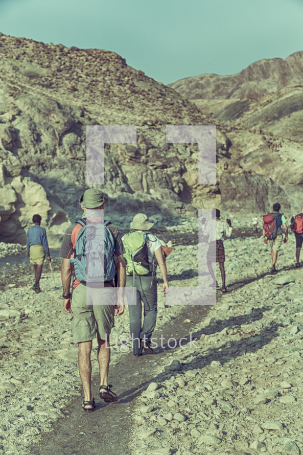 hikers exploring a canyon