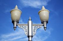 street lamp against a blue sky