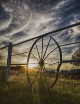 wagon wheel fence and wispy clouds