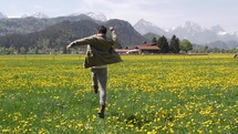 a man frolicking in a field of poppies in Germany