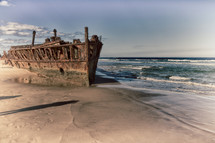 rusty old boat on a shore
