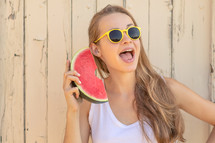 a teen girl holding a watermelon
