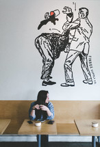 a woman sitting in a coffee shop
