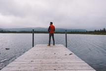 man standing on a dock