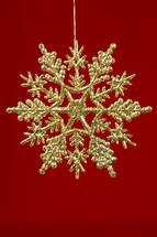 glittery gold snowflake ornament