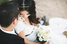 groom looking down at his bride
