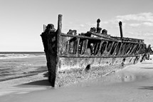 rusty ship washed up on a beach