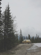 an iPhone capture of this retro camper van along a lonely mountain road