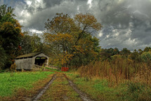 lightning in the clouds over a covered bridge