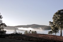 steam over a lake