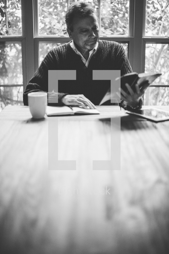 man reading a Bible at a Bible study