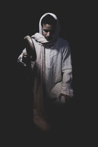 shepherd and his staff kneeling in prayer