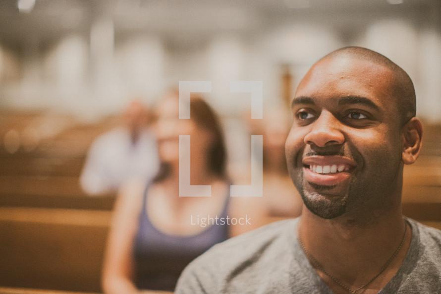 people sitting in church pews