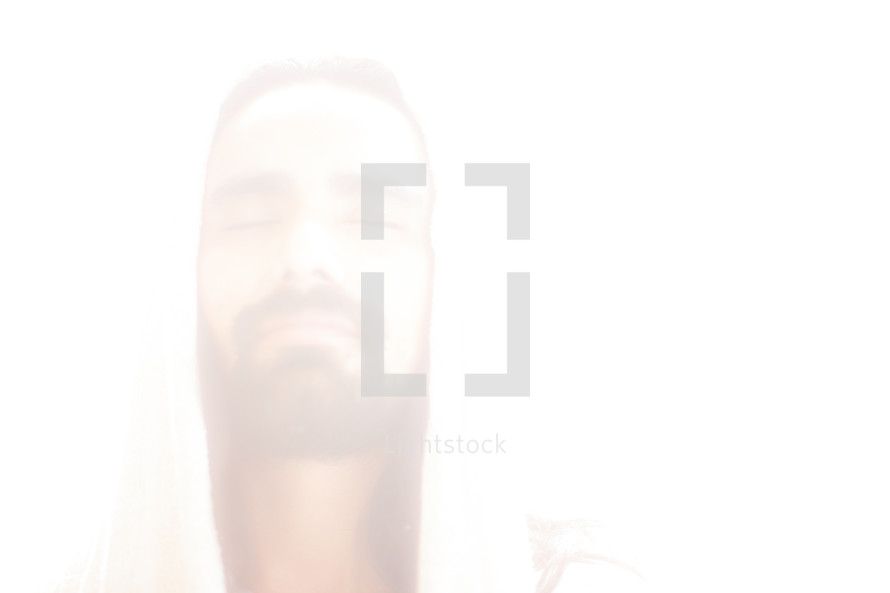 The resurrection -- a hooded Jesus in a ray of light.