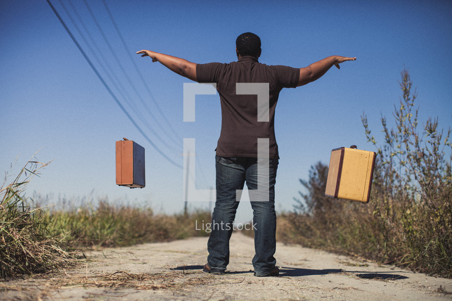 man throwing down luggage