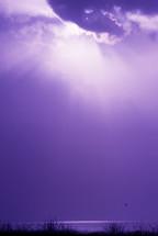 sun in a hazy sky over the ocean