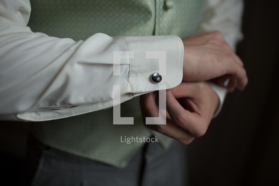 Man buttoning cufflink